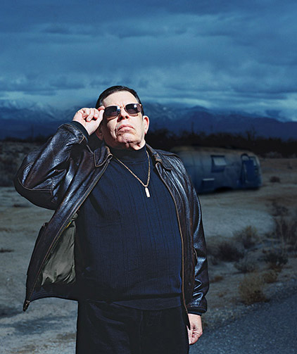 In the only known photo of the two together, noted talk radio host Art Bell poses with the notorious airstream trailer housing mjp visible in the background.